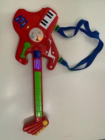 Gitara dla dziecka grająca , melodia światełka