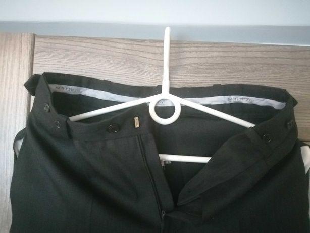 Spodnie eleganckie 140