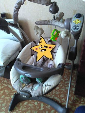 Продам детский укачиватель Graco Disney