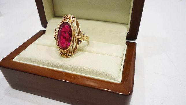 Złoty pierćionek z różowym oczkiem 583