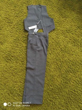 Школьный костюм (жилет+брюки) на 6- 8 лет