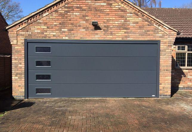 Ворота секционные гаражные в ассортименте