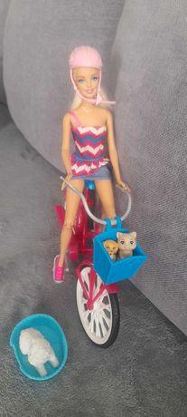 Lalka Barbie na rowerze
