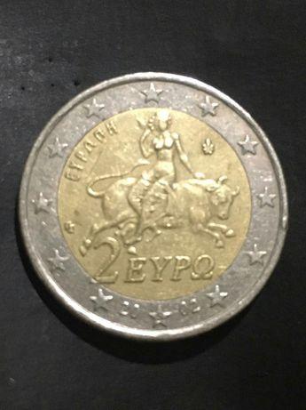 """Moeda 2€ da Grécia con """"s"""" na estrela."""