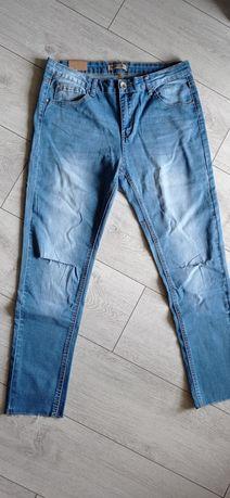 Nowe jeansy r.32