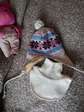 Zimowa czapka i oszukaniec
