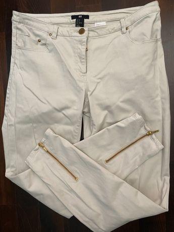 Beżowe spodnie H&M HM z zamkami zameczki jasne nude materiałowe M 38