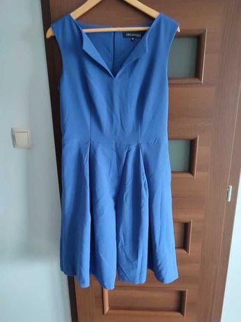 Modrakowa sukienka.