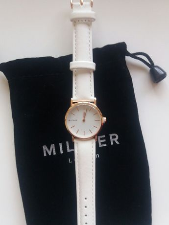 Кварцевые белые с золотом часы Milner