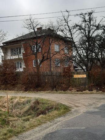Dom z budynkami gospodarskimi