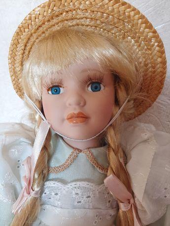 Кукла фарфоровая, новая.