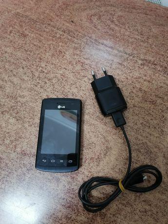 Telemóvel LG com carregador