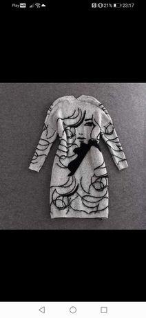 Przepiękne długie swetry