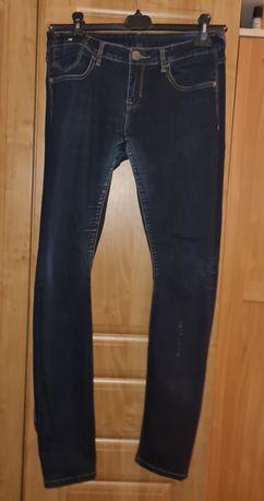 Spodnie damskie dzinsy rurki 36