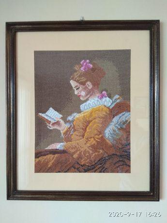 Kobieta czytająca książkę - haft krzyżykowy