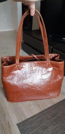 Кожанная сумка  рыжего цвета