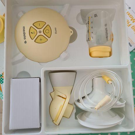 Bomba leite materno MEDELA + biberão Calma + sacos conserva leite