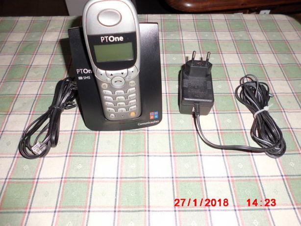 um telefone portatil com base de ligar á linha.