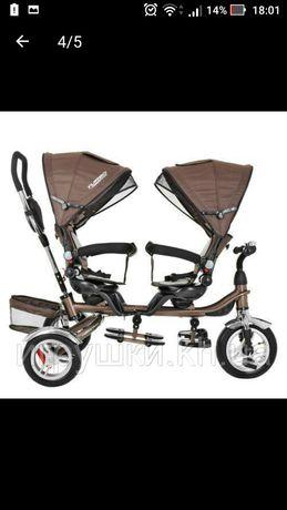 Велосипед для двойни с родительской ручкой