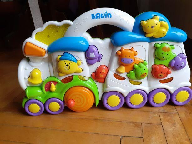 Zabawka interaktywną BRUIN pociąg. Wymiary : 40 x 24 cm.