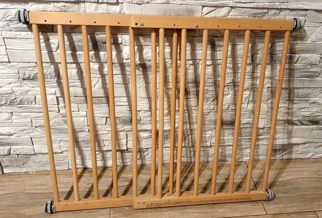 Bramka zabezpieczajaca drewniana na schody na śruby rozporowe.