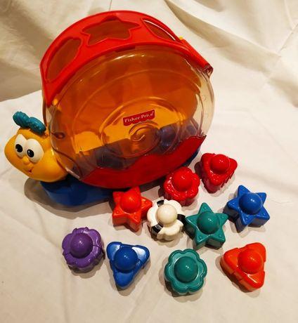 Lagarta Fisher Price com figuras geometricas para criança.