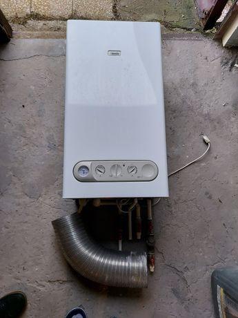 Piec gazowy dwufunkcyjny z otwartą komorą spalania.