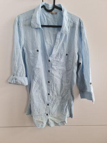 Koszula błękitna zapinana na guziki