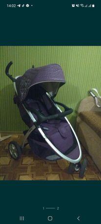 Каляска фіолетового кольору