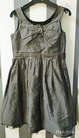 Dziewczęce eleganckie sukienki rozm 128 i 134 cm