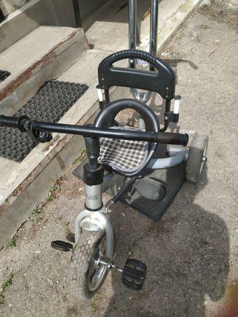 Трёхколёсный велосипед с ручкой