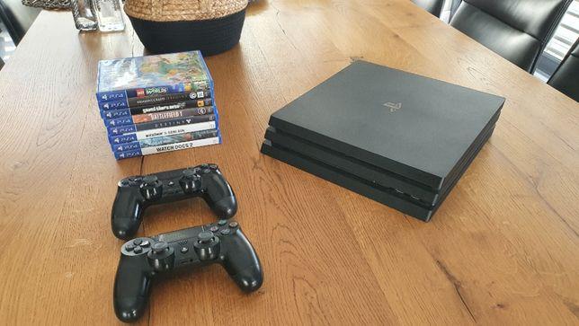 PS4 Pro 1T + 2 pady + 10 gier