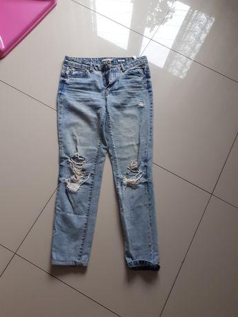 Spodnie dziury Reserved S