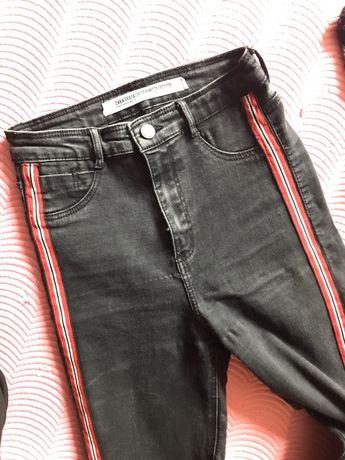 Czarne rurki z lampasami i dziurami na kolanach zara rozmiar 36