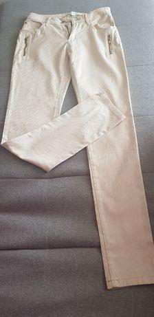 Nowe kremowe spodnie