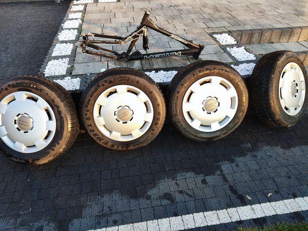 Komplet kół zimowych do Audi A4 B7  195/65 R15 Dunlop z kolpakami