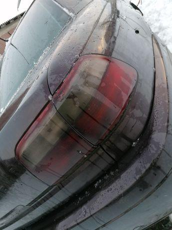 Lampy tył dymione 2szt Opel Omega B FL sedan