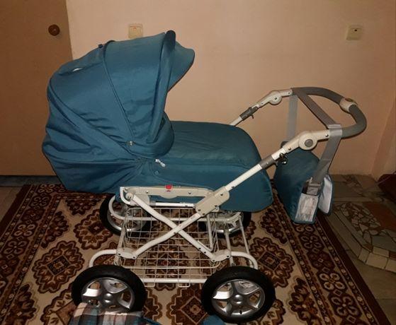 Универсальная коляска 2 в 1 Geoby + детские вещи  и игрушки в подарок.
