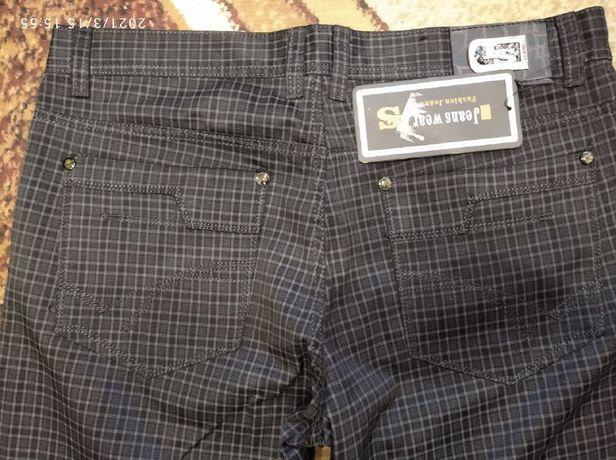 Черные джинсы в новом состоянии