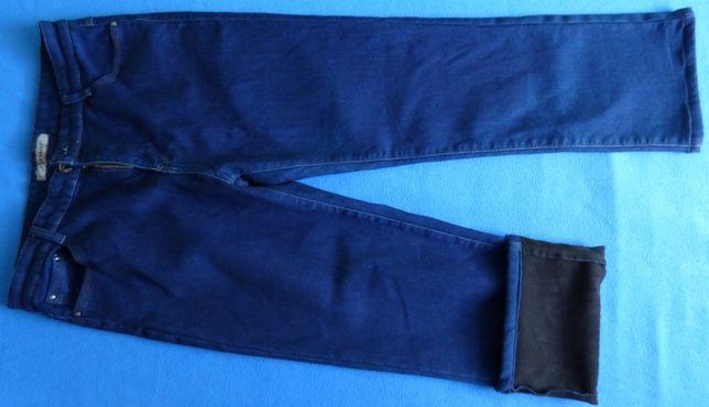 Spodnie Jeansy damskie z polarem i bez