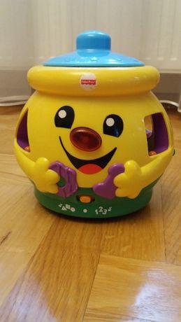 Zabawka edukacyjna Fisher Price Garnuszek na klocuszek