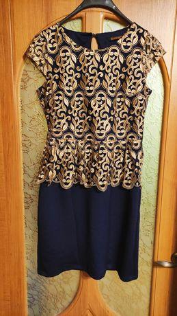 Нарядное женское платье с баской