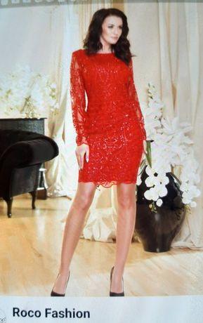 czerwona nowa sukienka z koronki.