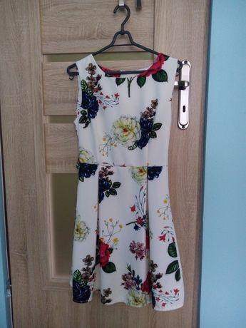 Sukienka w kwiaty biała L 40 midi biała sukienka bez rękawów do kolan