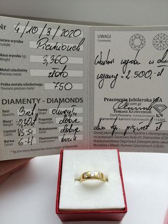 Złoty pierścionek z diamentami.