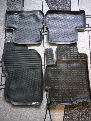 Резиновые оригинальные коврики на Mitsubishi Lancer X