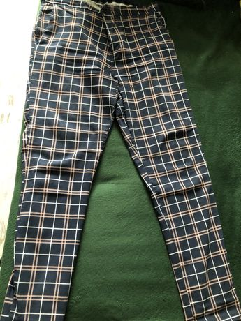 Spodnie damskie w modną kratę
