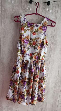 Urocza sukienka w kwiaty Atmosphere
