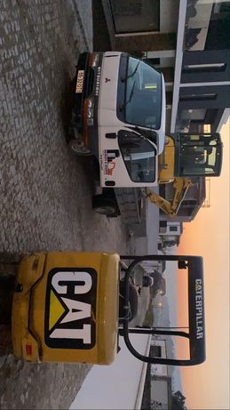 Serviços de mini giratória mini pá cargadora e carrinha de bascula