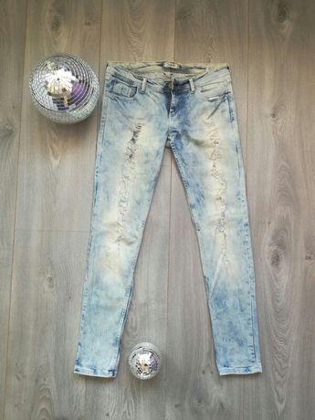 Spodnie jeansowe jeansy niebieskie z dziurami przetarciami pimkie